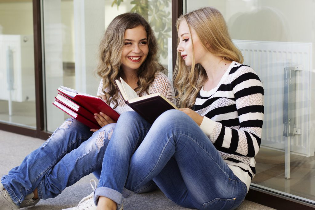 teen girls with books