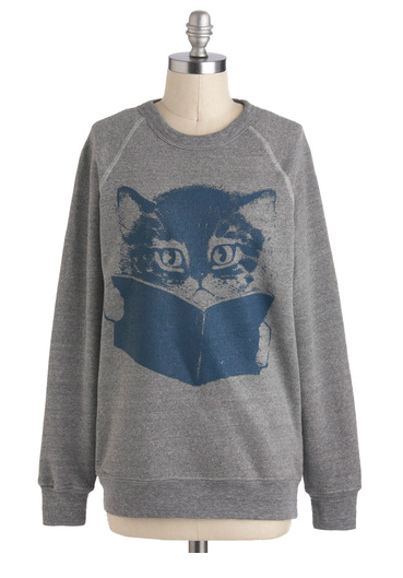 cat and book sweatshirt