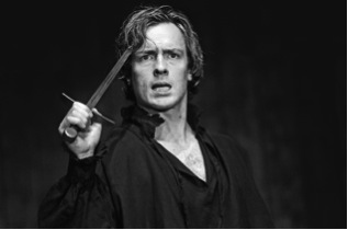 Hamlet at the Royal Shakespeare Company, with Toby Stephens as Hamlet, holding a bodkin